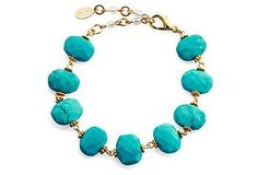 Made with chunky turquoise stones, this adjustable bracelet brings a splash of color and texture to any ensemble.