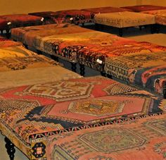 CR Laine Furniture ottomans made from vintage Turkish rugs come in many designs, colors, and sizes.  pinned with Pinvolve