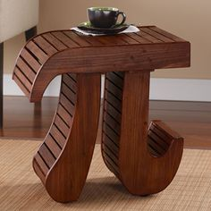 For the mathy among us, a small, sturdy handcrafted table whose curved top and legs form the pi symbol. Wood and MDF with a warm, natural finish, it's a place to set your coffee while you eat your pie, or read 'Life of Pi,' or ponder why pi are squared. 19' square, 14' high. Not for sitting or standing. Assembly required. No gift box or rush delivery.
