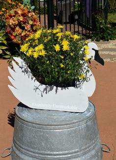 Swan Decoy Planter: transform an old wooden planter into beautiful rustic piece in no time at all...