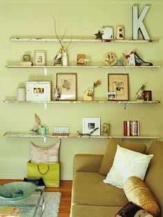 Flea Market Chic Storage - use narrow planks as display ledges to display found items  #Shelves  I'd like to do shelves like this made from old levels. Another thing I should look for while flea marketing this year... :)