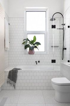 Bathtub surrounded by tile