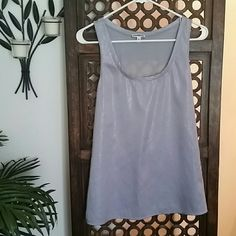 Gray Sparkly Tank Perfect for a day to night transition outfit. Sparkle/sheen on the front.  Only worn a couple times. No stains, holes, rips, or pilling. Non smoking home. Express Tops Tank Tops