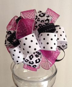 This whimsical gift bow is perfect for a girls gift topper or decoration. The bow is made with 1 1/2 wide black polka dot wire ribbon, 1 1/2 wide