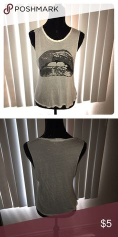 White graphic tshirt Used. ALL CLOTHING is either NWT or Preloved has been washed and sanitized and kept in a 🐾 pet free and 💨 smoke free home.   Too expensive gonna break the bank. Than add me to a 🛍 bundle deal or use the Offer 🖲 Button.    🚫NO LOW BALLING 🚫 Reasonable offers will be accepted, I do love negotiating. But Please Do Not 🚫🙅🏽 offer 40% below the asking price. Tops
