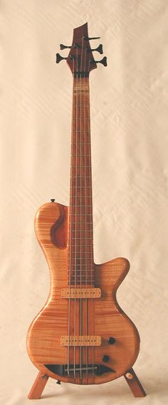 Denyle Guitars custom 5-string bass... like how the upper horn is solid but carve down to look more like a horn