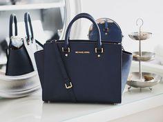 Michael Kors Selma navy. Buying this bag as a gift to myself!