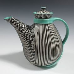 Gorgeous ceramics on this site! I love the color contrast and the carving by Shoshana Snow.