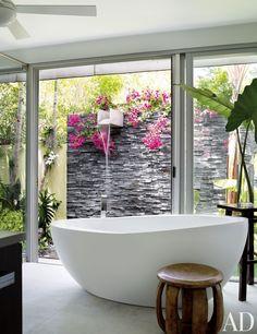 Exotic bathroom by Malcolm James Kutner Inc.