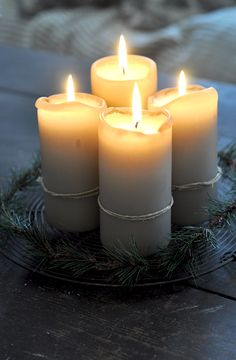 Candles:  Candles tied with raffia, on a plate with greenery.  Simple.  Lovely.
