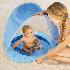 Baby Beach Shade Pool and over 7,500 other quality toys at Fat Brain Toys. Cool off at the beach without having to brave the waves! Just dig a shallow hole in the sand, place the pool base over the hole, attach the sun shade, and then fill it up with water. Within moments, your baby is splashing happily in his or her own personal beach pool!