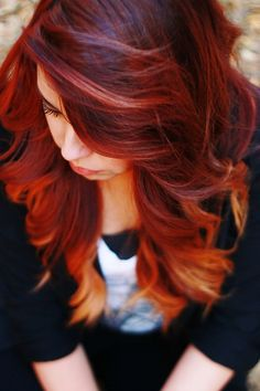 In another life! red hair- with blonde ombre. I love the low-lights up top, and the highlights on the bottom.