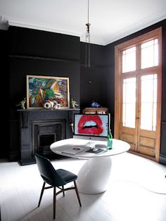 dark walls + french doors + fireplace