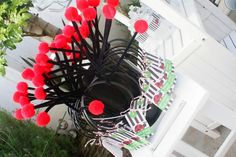Lady bug party hats - this was a great party!  Love the photo are they set up too.