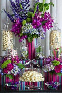 Candy buffet with flower arrangement