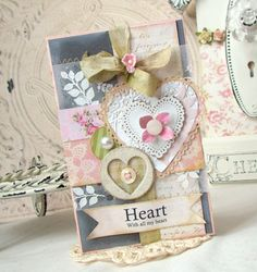Heart Shaby Chic Handmade card by iralamijashop on Etsy. Materials: paint, papers, chipboard, glitter buttons, lace, twill tape, cord, pearls, stamps.