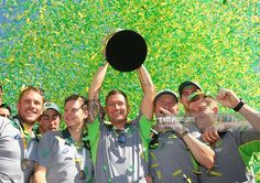 The Australian cricket team pose with the trophy during celebrations after winning the 2015 ICC Cricket World Cup Final at Federation Square on March 30, 2015 in Melbourne, Australia.