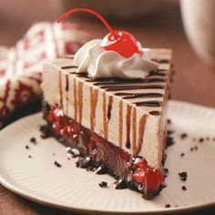 Luscious Black Forest Cheesecake Recipe -A friend gave me this recipe and it's quickly become popular at our house. I enjoy making it when we entertain. My husband and I are dairy farmers and have three pre-school age children. I enjoy trying new recipes as well as yardwork and crafts. —Patricia Plett, Blumenort, Manitoba