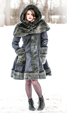 This faux fur coat came right out of our imagination. It makes you want to jump into fresh snow or ride in a horse drawn sled down through a