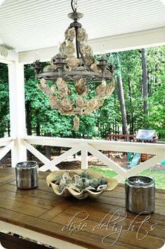 Oyster shell chandelier from Dixie Delights. I want to make a smaller version of this for our back porch.
