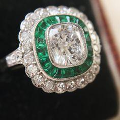 Sublime 1.03 carat D colour diamond cluster ring with calibrè cut emeralds.