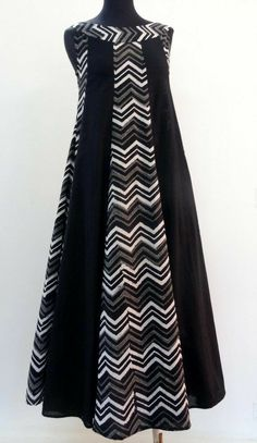 Mid-length dress with printed black and white cotton sleeveless in round neck. - - Mid-length dress with printed black and white cotton sleeveless in round neck. Batik Fashion, Abaya Fashion, Muslim Fashion, Fashion Dresses, Abaya Mode, Hijab Stile, Abaya Designs, Batik Dress, Mid Length Dresses