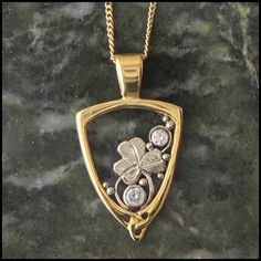 A simple and elegant pendant in 14K Gold with a shamrock and diamonds.