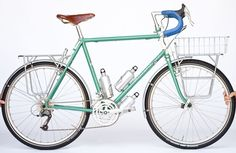 The classic touring bike has a steel frame, superstrong wheels, drop bars, a triple chainring, a low bottom bracket for stability when loade...