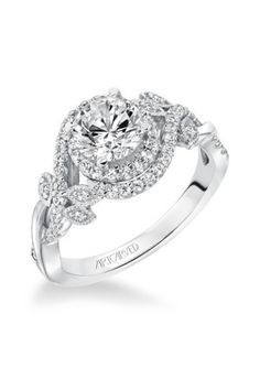 Contemporary design from Artcarved: http://www.stylemepretty.com/2014/11/01/30-of-our-most-coveted-engagement-rings/