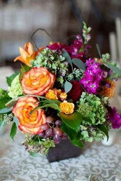 Purple and Orange Wedding Flowers Love the color combo in this bouquet! :)