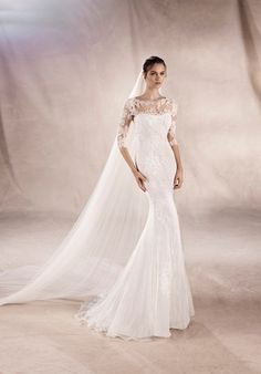 Incredible mermaid wedding dress in embroidered tulle, with lace appliqués. Sweetheart neckline and strapless neckline in crystal tulle and lace. The Knot provides price estimates to give you a general idea of the cost of a dress. Please visit retailers in your area for exact pricing. Prices will vary by region.