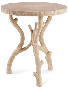 The Hanbury occasional table by Currey & Co. is a charming take on 19th-century European garden furniture