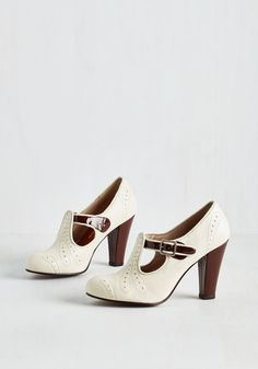 All that's left to pack for your upcoming trip is the perfect pair of pumps - these versatile, vintage-inspired heels! Brogue-like details adorn the rounded toe and counter of this silver-buckled duo as a glossy, chocolate brown strap and heel give your glam leather look an air of cross-country chic.