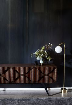 The Glissandro Credenza by Jon Goulder from JAM FACTORY, and the Oscar Brass floor lamp by CTO LIGHTING