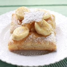 Banana Pillows -- bananas in a brown sugar sauce stuffed inside of a puff pastry pillow, then dusted with powdered sugar.