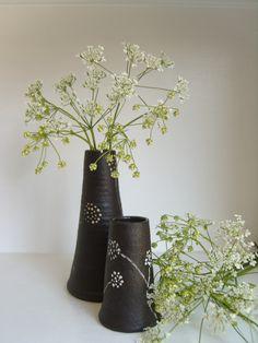 bud vases - black slip background and white slip decoration.  Unglazed exterior, glazed interior. Judy Adams Ceramics