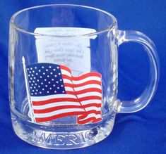 """American Flag Coffee Mug 13 oz Overall Size: 3.75"""" Tall This mug is a great addition to any collection. It features an American flag on one side and the Pledge of Allegiance on the reverse. Also, the"""