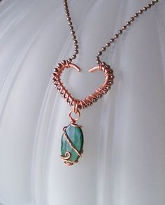 OOAK Art Pendant Necklace -  Copper Wire Wrapped Heart and Paua or Abalone Shell and Oxidized Silver Plate. $24.00, via Etsy.