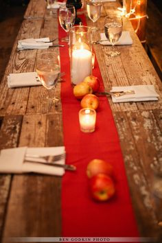 wood table, red runner, apples with @Pearl Events Austin