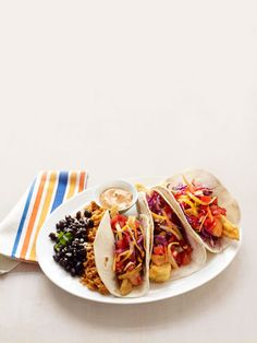 Mmm... fish tacos. Ours are just as crispy (yeah, they're fried) as On the Border's, but with a third of the calories. Increíble! Recipe: Healthier Fish Tacos
