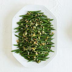 Tired of traditional Green Bean Casserole?  Try Green Beans Gremolata with lemon, garlic, parmesan cheese topped with pine nuts!
