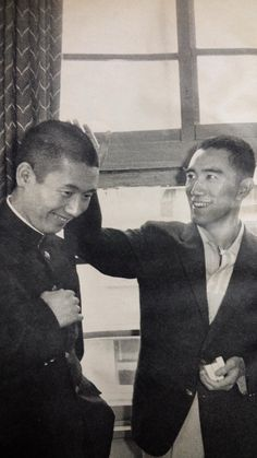 "Yukio Mishima with Raizo Ichikawa during the filming of Enjô 炎上 (Conflagration), 1958. Directed by Kon Ichikawa and starring Raizo Ichikawa. Adapted from the Yukio Mishima novel, ""The Temple of the Golden Pavilion."""