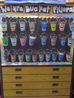 Buckets made from clear solo cups, holes punched in sides, and handles made out of sparkly pipe cleaners. Kids decorate buckets.