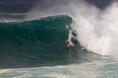 Quiksilver in Memory of Eddie Aikau Kelly Slater on a heavy set wave during Round 1 of the Eddie. Photo WSLKeoki wsl official WORLD SURF LEAGUE