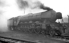 Gresley 4-8-2.Seen here in the early '60's after the fitting of continental type smoke deflectors in pretty run down condition.  Matthew Cousins