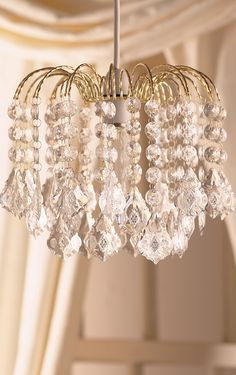 Fountain like acrylic chandelier with gold finish