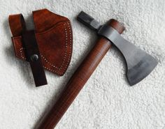 Hand-forged hammer poll tomahawk with curly ash handle