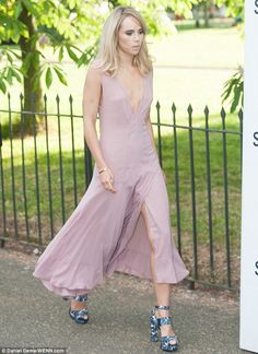 Here she comes: Suki Waterhouse teamed her dress with a pair of distinctive chunky heels...