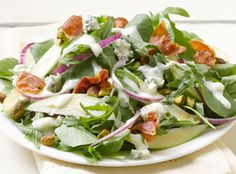 "Watercress Arugula Salad  Peppery arugula, tart apples and tangy Simply Dressed® Blue Cheese Salad Dressing give this scrumptious salad just enough ""bite.""  From Marzetti Kitchens℠."