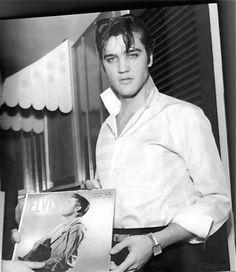 "Elvis holding his first ""Gold"" album"